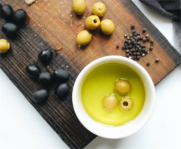 Health Effects of Olive Oil: From Lamp Oil to Kitchen Staple